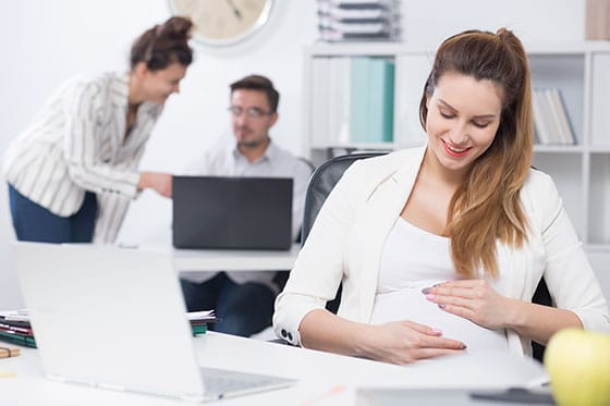 Women pregnant at work
