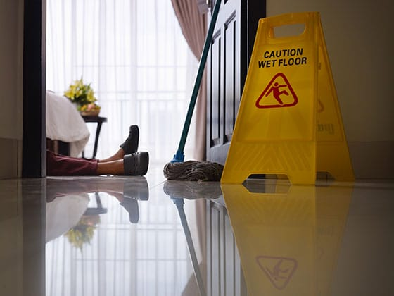 Slip and fall by wet floor sign