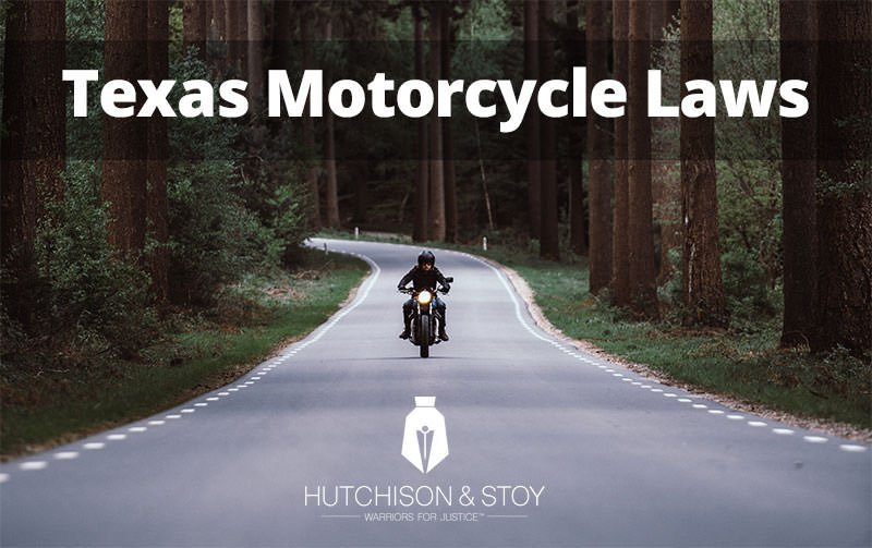 Motorcycle on Road with Texas Motorcycle Law Caption