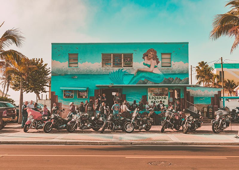 Motorcycles parked in front on building