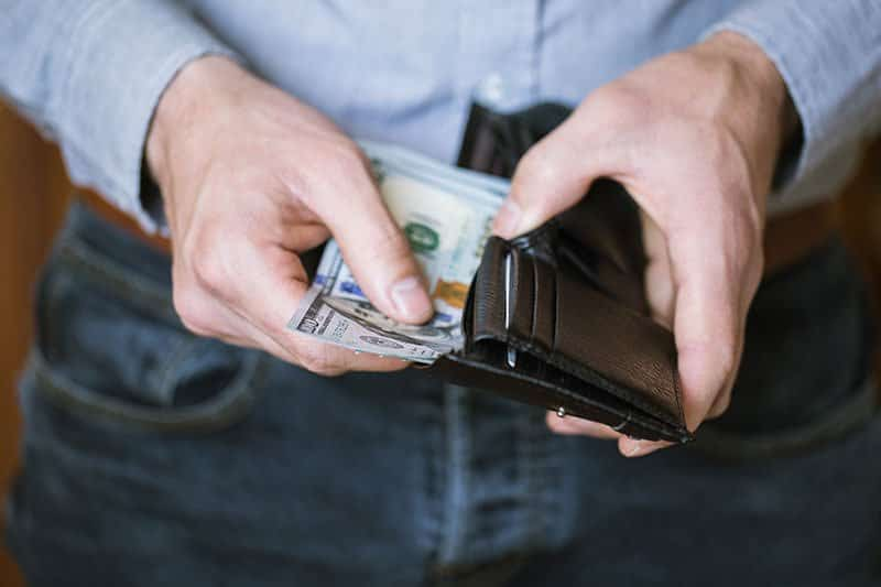 Man removing lost earning from wallet